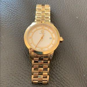 Brand new Tori Burch gold tone watch